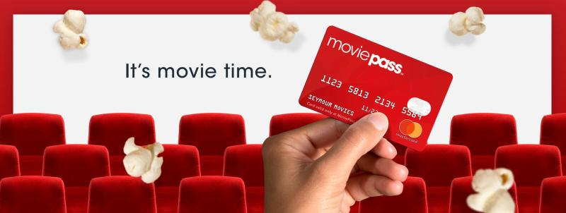 MoviePass ad with a MoviePass card at a theater with popcorn kernels.