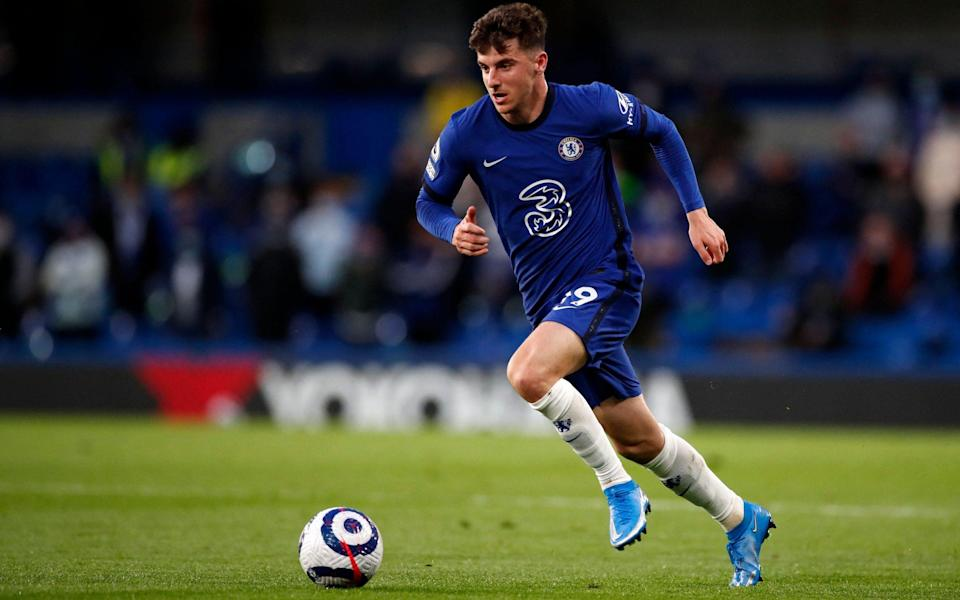 Chelsea's English midfielder Mason Mount runs with the ball during the English Premier League football match between Chelsea and Leicester City at Stamford Bridge in London on May 18, 2021. - PETER CZIBORRA/POOL/AFP via Getty Images