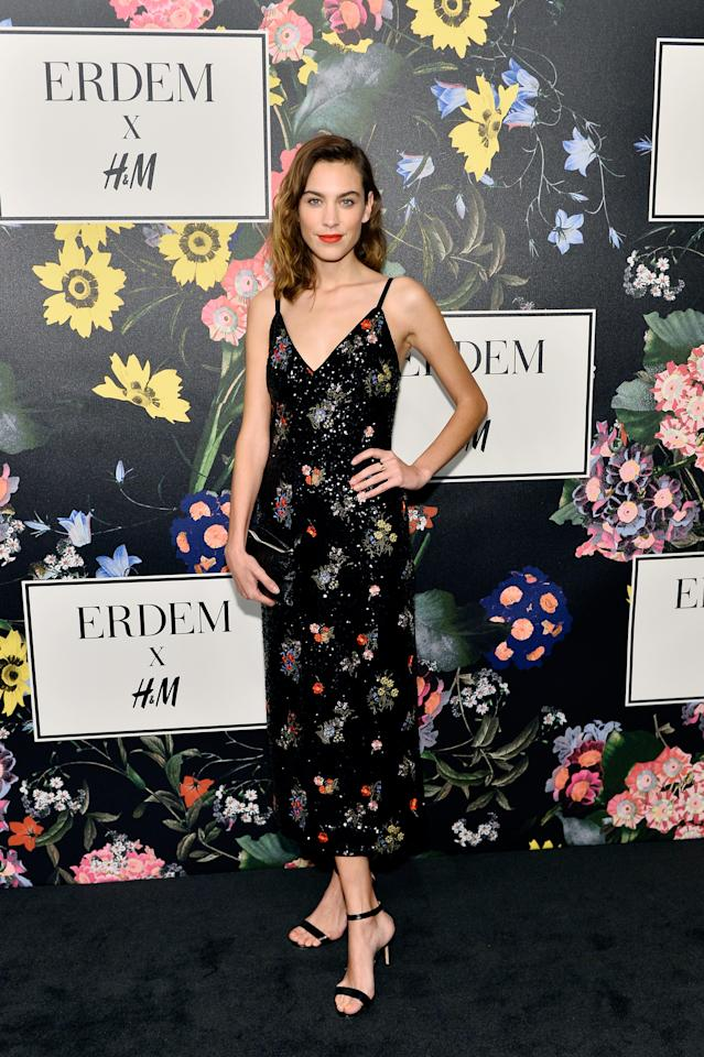 <p>Alexa looked every inch the glamourpuss in a slinky floral slip dress, which will set you back £149.99. [Photo: Courtesy of H&M] </p>
