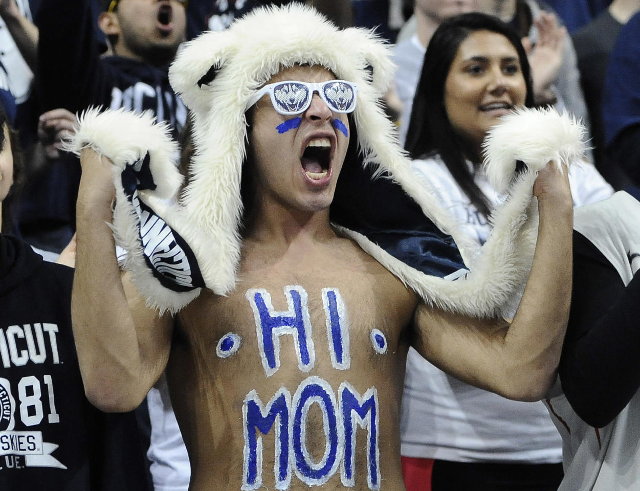 A Connecticut student cheers inside Gampel Pavilion in Storrs., Conn., Monday April 7, 2014, as they watch the broadcast of the UConn men's basketball team attempt to win a fourth NCAA title and a second in the last four years against Kentucky. (AP Photo/Jessica Hill)