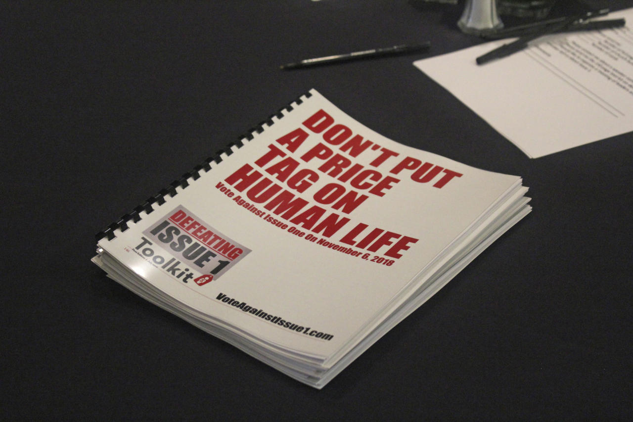 """In this July 26, 2018 photo, an information booklet about a """"tort reform"""" measure appearing on Arkansas' ballot sits on a table at a breakfast meeting of pastors in Little Rock, Arkansas. The Family Council Action Committee, a conservative Christian group, is rallying churches against the ballot measure to impose new limits on lawsuit damages. (AP Photo/Andrew Demillo)"""