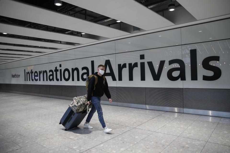 LONDON, ENGLAND - AUGUST 22: Travellers arrive at Heathrow Airport on August 22, 2020 in London, England. As of Saturday morning at 4am, travellers arriving in England from Austria, Croatia, and Trinidad and Tobago were required to quarantine themselves for 14 days. At the same time, travellers from Portugal were no longer required to quarantine. (Photo by Hollie Adams/Getty Images)
