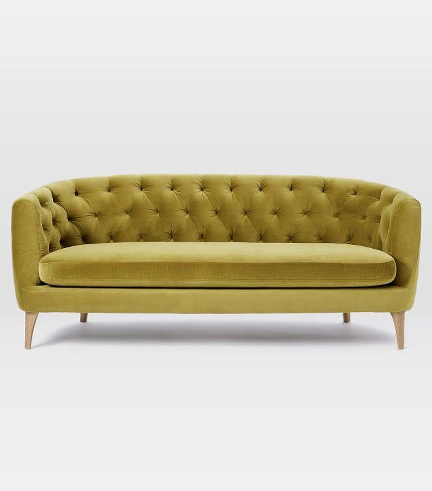 Go bold with a colorful tufted sofa with vintage vibes.