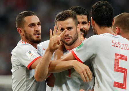Soccer Football - World Cup - Group B - Portugal vs Spain - Fisht Stadium, Sochi, Russia - June 15, 2018 Spain's Nacho celebrates scoring their third goal with Koke and team mates REUTERS/Murad Sezer