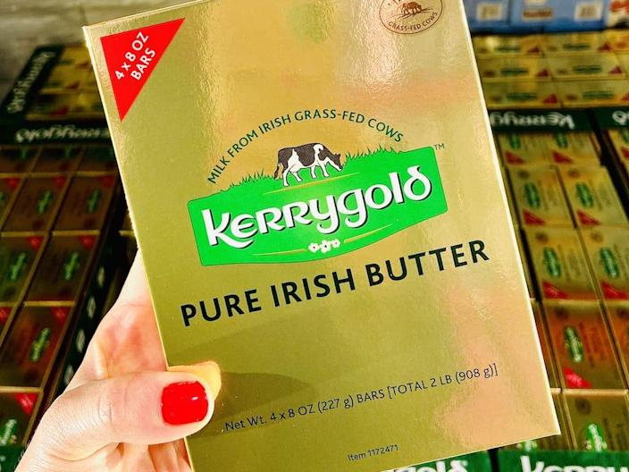 hand holding gold package of kerrygold irish butter