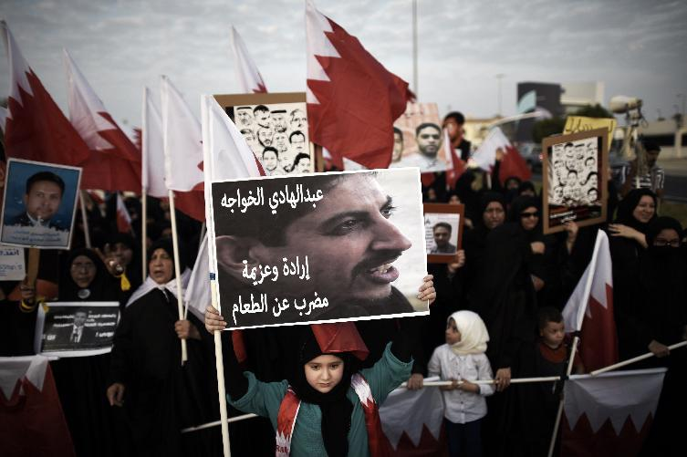 A Bahraini girl holds up a placard bearing a portrait of jailed human rights activist Abdulhadi al-Khawaja during an anti-government protest in the village of Jannusan, west of the capital Manama on September 5, 2014 (AFP Photo/Mohammed Al-Shaikh)