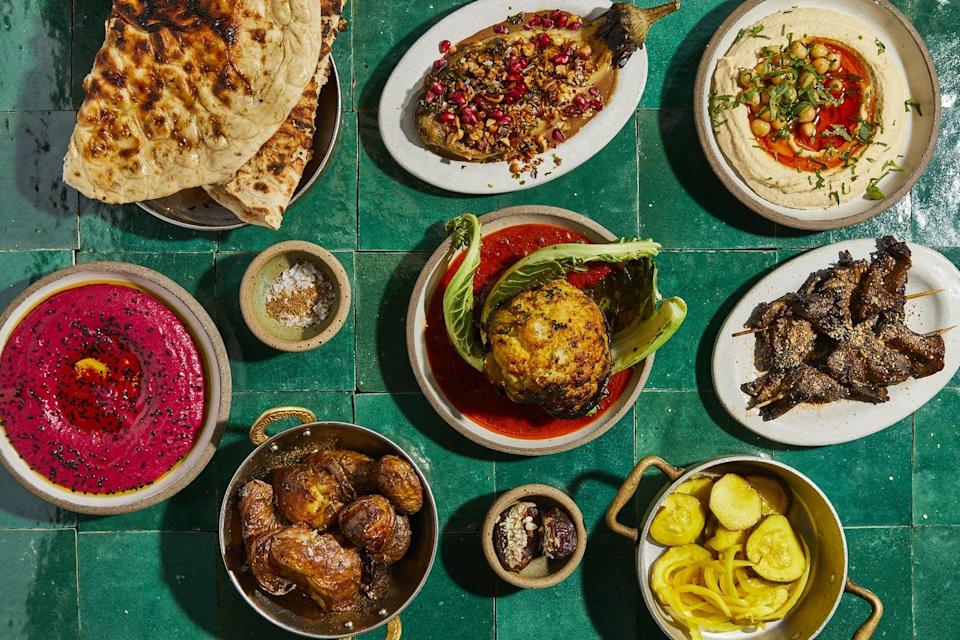 """<p>If you've got a hearty appetite then Bubala is the one for you. A Middle Eastern restaurant founded by Marc Summers and Helen Graham in October 2019, this is a food hub that serves both a vegetarian and vegan menu. If we could eat here every night, we would. </p><p>With menus titled 'Bubala Knows Best', you'll be in good hands thanks to the expertise of head chef Graham. Tuck into vegan delights such as laffa bread, beetroot borani, (with pomegranate molasses and dill), the most mouthwatering oyster mushroom skewers (coated in tamar, coriander seed and maple), tasty fried aubergine in zhoug and date syrup and several more plates. </p><p>Guardian critic, Jay Rayner, recently said of Bubala: 'If you love vibrant Mediterranean dishes, Bubala will be your East End sweetheart.' And we couldn't agree more.</p><p>For more info, click <a href=""""https://bubala.co.uk/"""" rel=""""nofollow noopener"""" target=""""_blank"""" data-ylk=""""slk:here"""" class=""""link rapid-noclick-resp"""">here</a>. </p>"""
