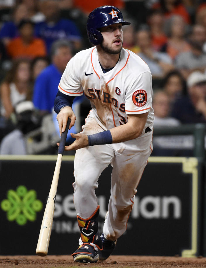 Houston Astros' Kyle Tucker watches his two-run home run during the seventh inning of a baseball game against the Texas Rangers, Saturday, May 15, 2021, in Houston. (AP Photo/Eric Christian Smith)