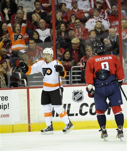 Philadelphia Flyers defenseman Bruno Gervais (27) celebrates his goal as Washington Capitals left wing Alex Ovechkin (8), of Russia, looks on during the second period of an NHL hockey game on Friday, Feb. 1, 2013, in Washington. (AP Photo/Nick Wass)