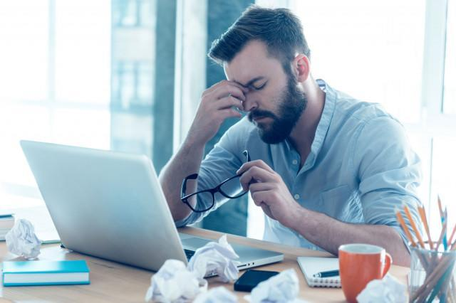 improve security warnings exhausted man computer problems desk hacking hackers malware frustration