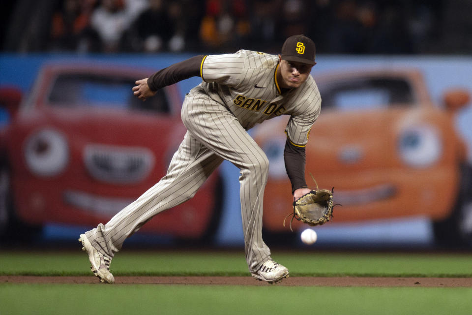 San Diego Padres third baseman Manny Machado fields a grounder by San Francisco Giants' Buster Posey during the fourth inning of a baseball game Tuesday, Sept. 14, 2021, in San Francisco. Posey was out at first. (AP Photo/D. Ross Cameron)