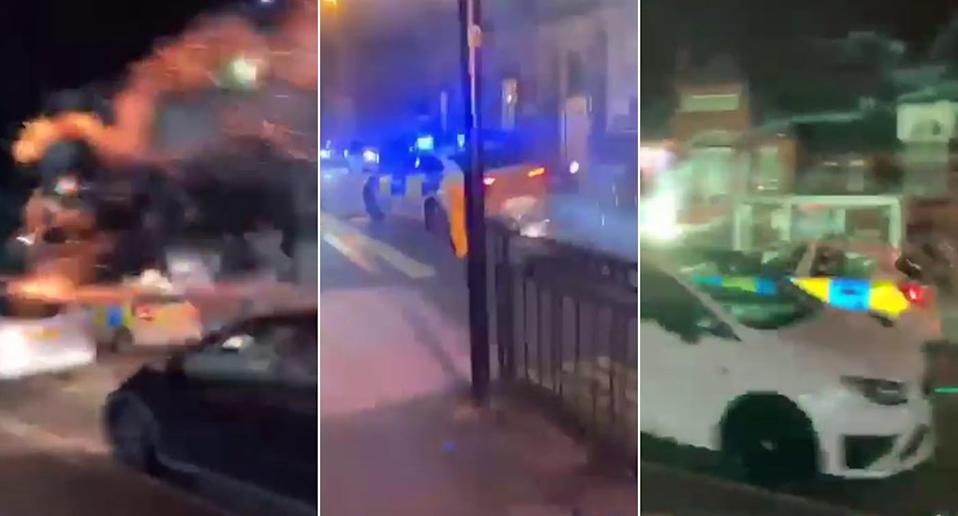 A police car came under attack from fireworks in Birmingham on Halloween night. (SWNS)
