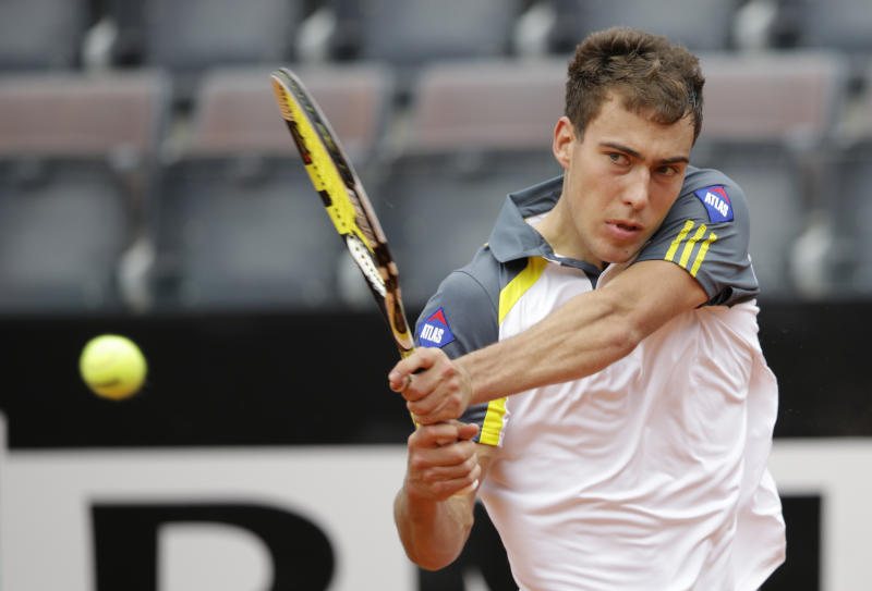 Jerzy Janowicz of Poland returns the ball to Jo-Wilfried Tsonga of France during their match at the Italian Open tennis tournament in Rome, Wednesday, May 15, 2013. Janowicz won 6-4, 7-6 (7-5).(AP Photo/Andrew Medichini)