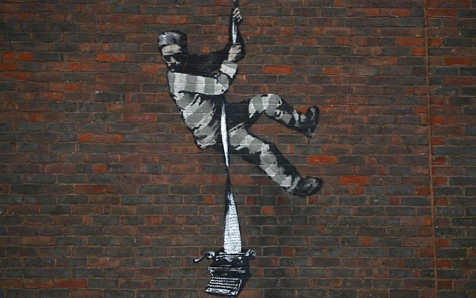The Banksy shortly after it appeared at Reading Jail on March 2 - AFP