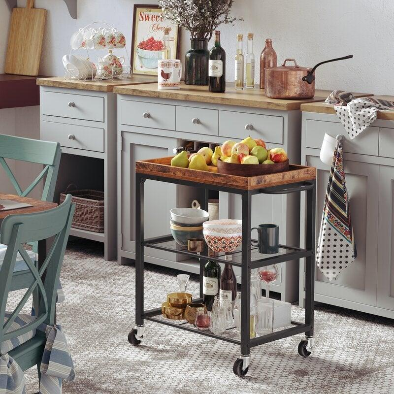 """<br><br><strong>Millwood Pines</strong> Hassell Kitchen Cart with Manufactured Wood Top, $, available at <a href=""""https://go.skimresources.com/?id=30283X879131&url=https%3A%2F%2Fwww.wayfair.com%2Ffurniture%2Fpdp%2Fmillwood-pines-hassell-kitchen-cart-with-manufactured-wood-top-w003003460.html"""" rel=""""nofollow noopener"""" target=""""_blank"""" data-ylk=""""slk:Wayfair"""" class=""""link rapid-noclick-resp"""">Wayfair</a>"""