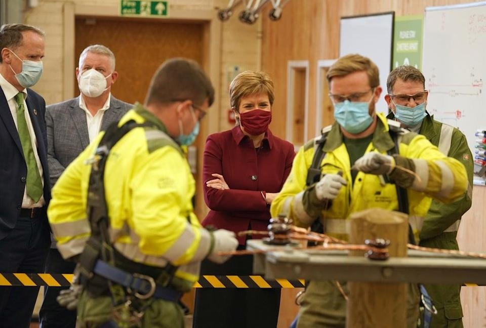 The First Minister met apprentices during her visit to Scottish Power in Cumbernauld (Andrew Milligan/PA) (PA Wire)