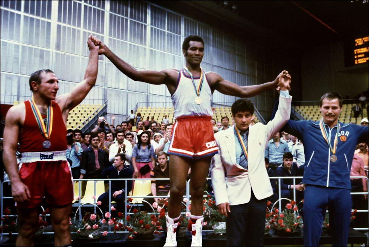 Cuban champion Teofilo Stevenson (C-gold medal) Soviet Pyotr Zaev (L-silver medal) and German Republic Democratic Jurgen Fanghanel (R- bronze medal) wawe on the podium of the Olympic heavyweight 81+ boxing event that won Teofilo Stevenson. Stevenson --who won 301 of the 321 fights he took part-- died of a heart attack at the age of 60 in Havana on June 11, 2012. AFP PHOTOSTAFF/AFP/GettyImages