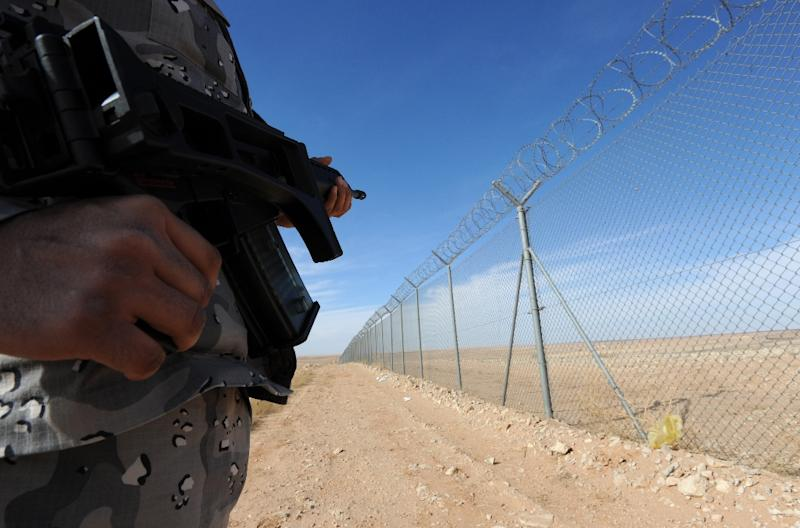 A member of the Saudi border guards patrols the fence on Saudi Arabia's northern border with Iraq, near Arar City on February 23, 2015