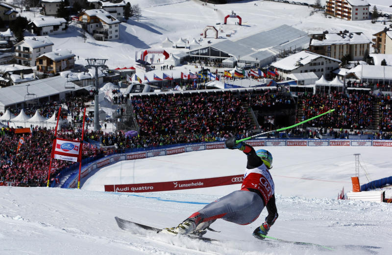 Ted Ligety from the United States, speeds down the course during the men's giant slalom at Alpine skiing World Cup finals in Lenzerheide, Switzerland, Saturday, March 16, 2013.(AP Photo/Shinichiro Tanaka)