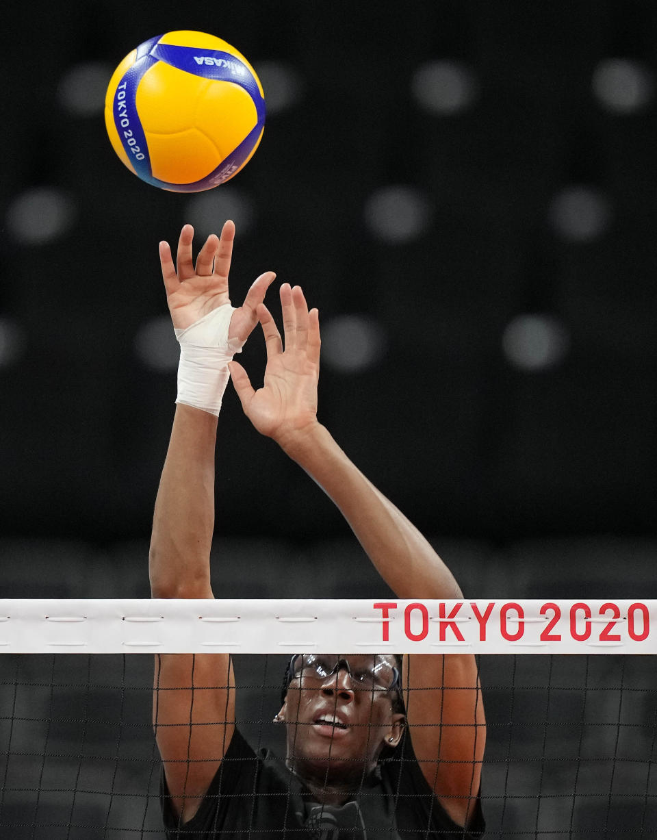 Foluke Akinradewo Gunderson blocks the ball as she practices with United States women's volleyball team during a training session at Ariake Arena at the 2020 Summer Olympics, Thursday, July 22, 2021, in Tokyo, Japan. A third trip to the Olympics was far from a sure thing for Gunderson when she gave birth to her first son in November 2019. But Gunderson had set a goal of being both a mother and professional athlete and took advantage of the delayed Olympics to make it back again this year in search of that elusive gold medal. (\(AP Photo/Frank Augstein)