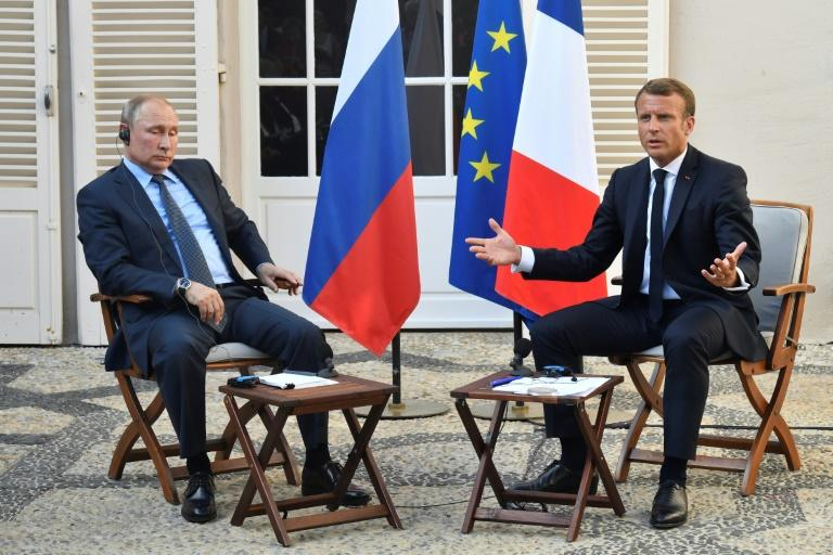 French President Emmanuel Macron (R) meets with Russia's President Vladimir Putin, at his summer retreat of the Bregancon fortress on the Mediterranean coast, near the village of Bormes-les-Mimosas, southern France