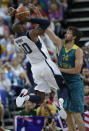 USA's Kobe Bryant (10) is defended by Australia's Matt Nielsen (14) during a quarterfinal men's basketball game at the 2012 Summer Olympics, Wednesday, Aug. 8, 2012, in London. (AP Photo/Eric Gay)