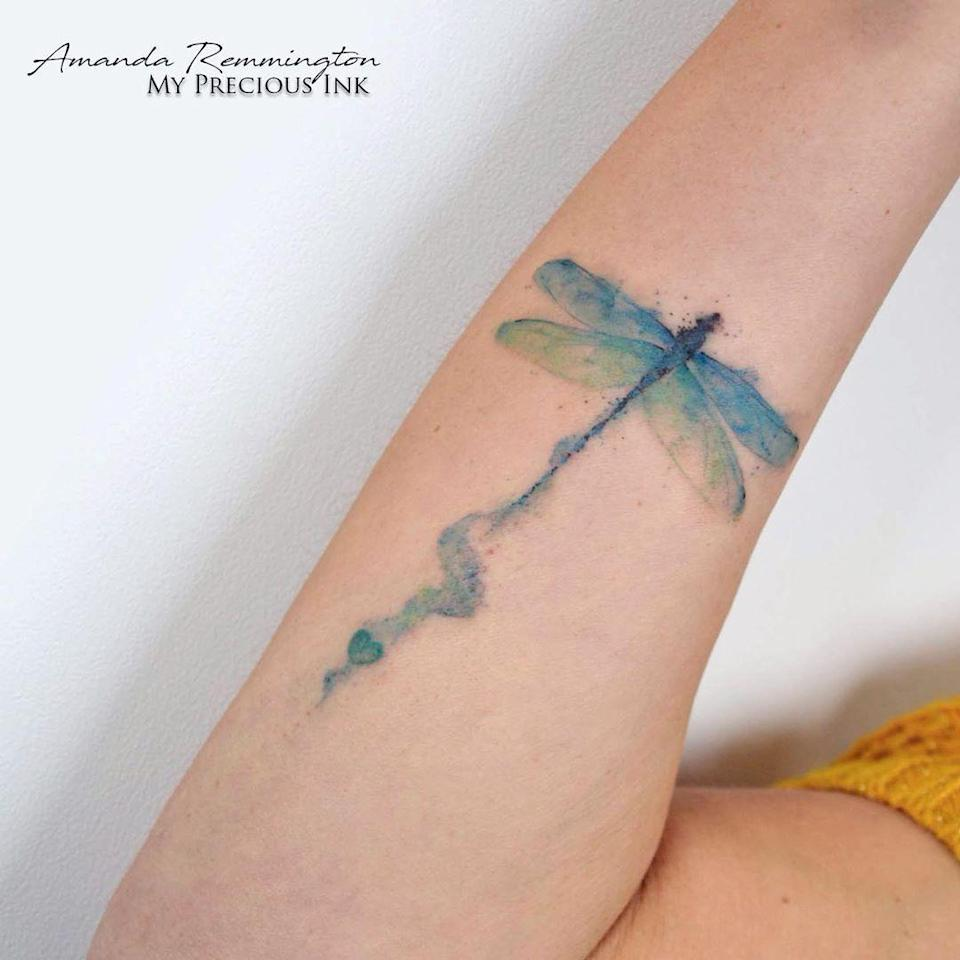The blue and green hues in this dragonfly tattoo are so realistic. Did you spot the heart in the trail?