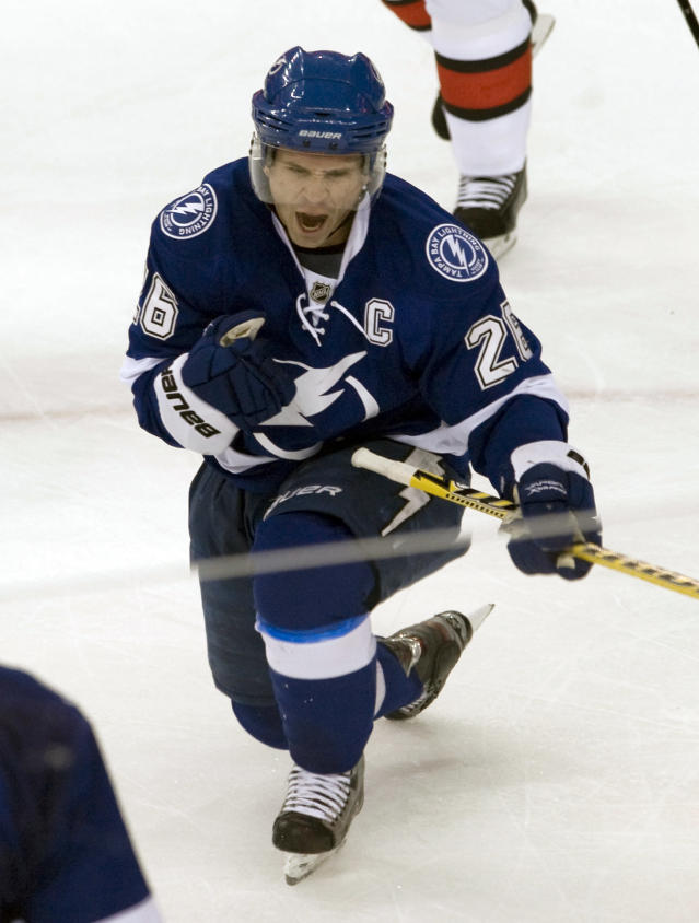 Tampa Bay Lightning's Martin St. Louis celebrates his goal against the Ottawa Senators during the second period of an NHL hockey game on Thursday, Dec. 5, 2013, in Tampa, Fla. (AP Photo/Steve Nesius)
