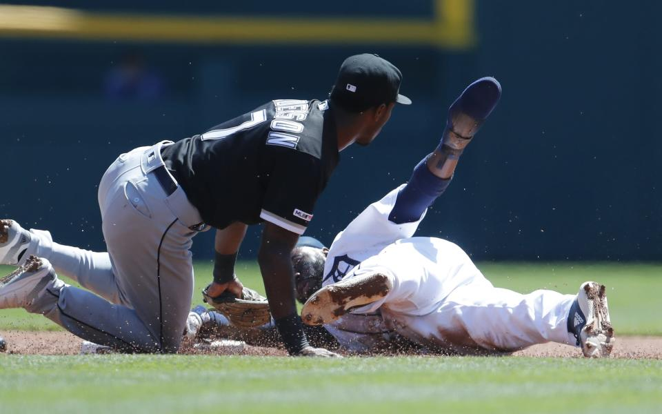 Detroit Tigers' Josh Harrison, right, is tagged out by Chicago White Sox shortstop Tim Anderson, left, on an attempted steal during the first inning of a baseball game, Sunday, April 21, 2019, in Detroit. (AP Photo/Carlos Osorio)