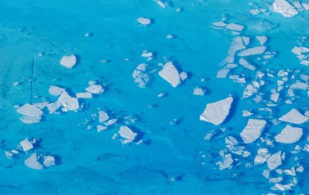 The U.S. is the world's second-highest greenhouse gas emitter. Here, chunks of ice float inside of meltwater pools on top of the Helheim glacier near Tasiilaq, Greenland, in 2018.