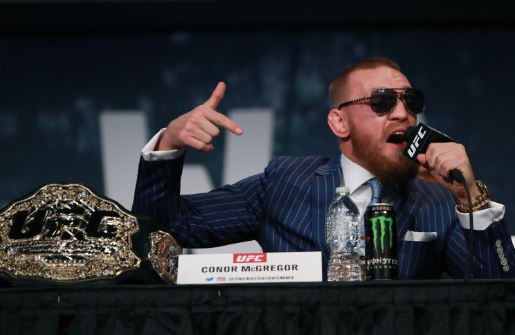 Conor McGregor made history at UFC 205, winning the lightweight title to hold two belts simultaneously. (Getty)
