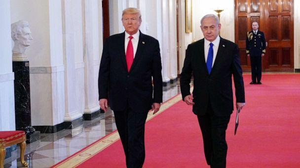 PHOTO: President Donald Trump and Israeli Prime Minister Benjamin Netanyahu arrive for an announcement of Trump's Middle East peace plan in the East Room of the White House in Washington, D.C on Jan. 28, 2020. (Mandel Ngan/AFP via Getty Images)