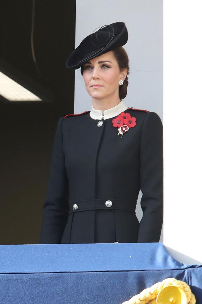<p>For Remembrance Sunday, the Duchess of Cambridge wore an Alexander McQueen military-inspired coat with a Lock & Co. Hatters hat and Cassandra Goad earrings. <em>[Photo: Getty]</em> </p>