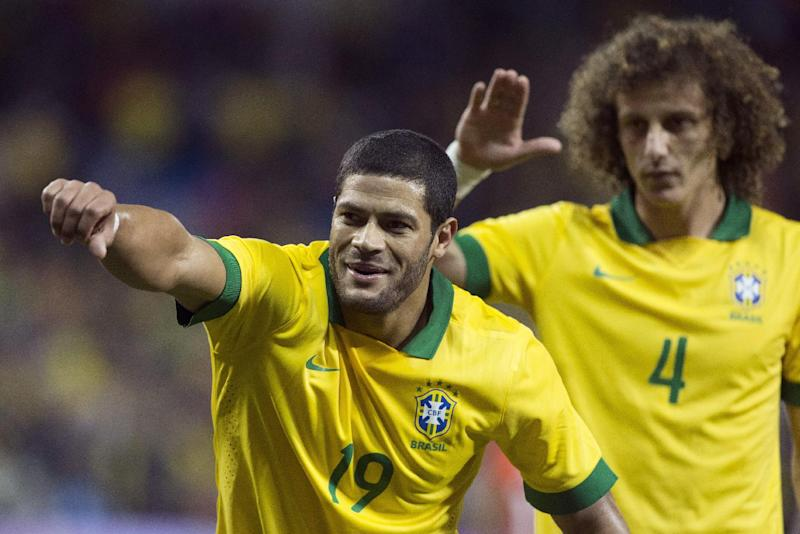 Brazil's Hulk (left) celebrates scoring his team's opening goal against Chile as teammate David Luiz looks on during first half action of their international friendly match in Toronto on Tuesday, Nov. 19, 2013