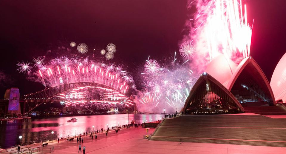 The Sydney Harbour fireworks display is seen over a near-empty Sydney Opera House forecourt. Source: Brook Mitchell/Getty Images