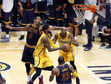 Apr 20, 2017; Indianapolis, IN, USA; Indiana Pacers forward Paul George (13) takes a shot against Cleveland Cavaliers forward Channing Frye (8) in game three of the first round of the 2017 NBA Playoffs at Bankers Life Fieldhouse. Cleveland defeats Indiana 119-114. Mandatory Credit: Brian Spurlock-USA TODAY Sports