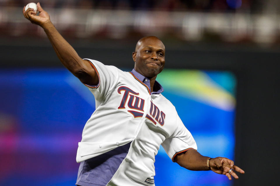 """FILE - In this Monday, Oct. 7, 2019 file photo, former Minnesota Twins baseball player Torii Hunter throws out the ceremonial first pitch before Game 3 of the American League Division Series between the Twins and the New York Yankees, in Minneapolis. More than a dozen Black men, including Hunter, say the Red Sox have turned a deaf ear to claims they were sexually molested by former Red Sox clubhouse manager Donald """"Fitzy"""" Fitzpatrick who pleaded guilty to attempted child sexual battery before his death in 2005. (AP Photo/Bruce Kluckhohn)"""