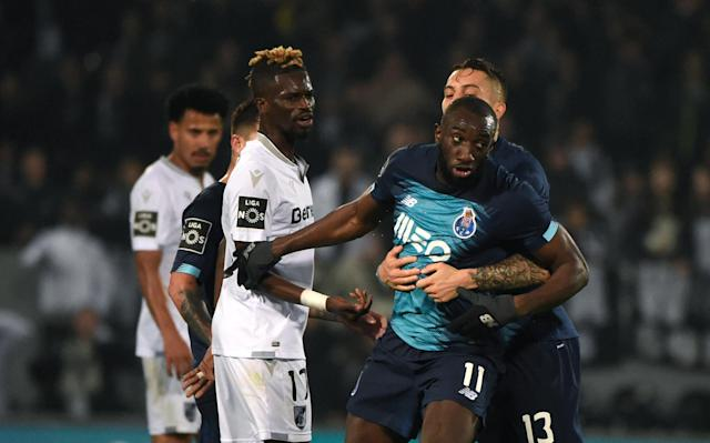 FC Porto's Malian forward Moussa Marega attempts to leave the pitch after hearing monkey chants following his goal. (MIGUEL RIOPA/AFP via Getty Images)