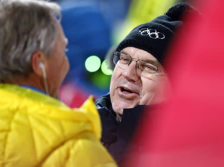 FILE PHOTO - Ski Jumping - Pyeongchang 2018 Winter Olympics - Men's Large Hill Individual Final - Alpensia Ski Jumping Centre - Pyeongchang, South Korea - February 17, 2018 - International Olympic Committee (IOC) President Thomas Bach talks to FIS Ski Jumping Race Director Walter Hofer. REUTERS/Kai Pfaffenbach