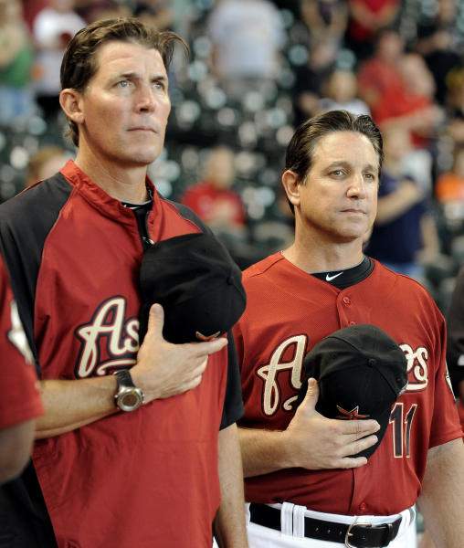 Houston Astros new interim manager Tony DeFrancesco, right, and new hitting coach Ty Van Burkleo stand for the national anthem before a baseball game against the Arizona Diamondbacks, Sunday, Aug. 19, 2012, in Houston. DeFrancesco replaced Brad Mills. (AP Photo/Pat Sullivan)