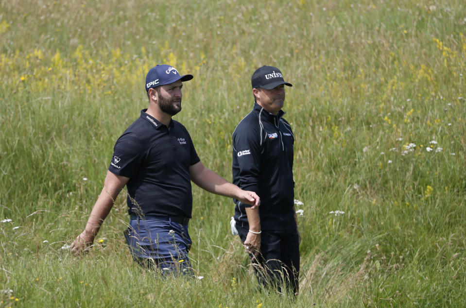 Spain's Jon Rahm, left, walks to the 3rd green during a practice round for the British Open Golf Championship at Royal St George's golf course Sandwich, England, Tuesday, July 13, 2021. The Open starts Thursday, July, 15. (AP Photo/Peter Morrison)