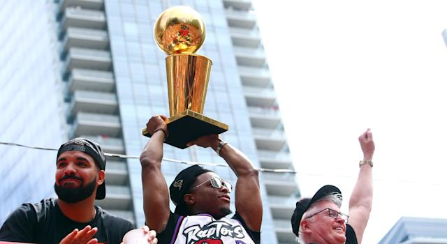 The Toronto rapper's performance at his label's multi-day festival included a welcomed appearance by the NBA championship trophy. (Photo by Vaughn Ridley/Getty Images)