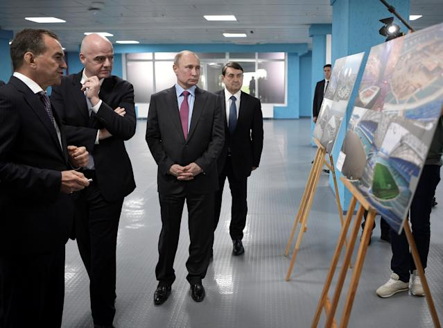 Russian President Vladimir Putin (2nd R), Presidential Aide Igor Levitin (R), Governor of the Krasnodar Region Veniamin Kondratyev (L) and FIFA President Gianni Infantino visit the Fisht Stadium, which will host matches of the 2018 FIFA World Cup in Sochi, Russia May 3, 2018. Sputnik/Aleksey Nikolskyi/Kremlin via REUTERS ATTENTION EDITORS - THIS IMAGE WAS PROVIDED BY A THIRD PARTY.