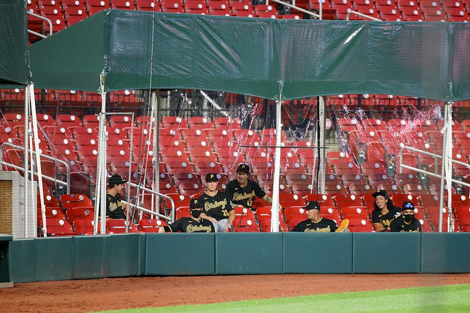 ST. LOUIS, MO - JULY 24: Members of the Pittsburgh Pirates watch the Opening Day game against the St. Louis Cardinals from the extended dugout at Busch Stadium on July 24, 2020 in St. Louis, Missouri. The 2020 season had been postponed since March due to the COVID-19 pandemic. (Photo by Scott Kane/Getty Images)