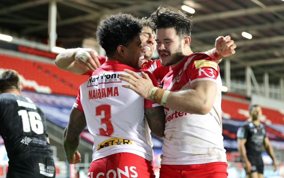 St Helens' Kevin Naiqama celebrates scoring his side's third try of the game during the Betfred Super League, Play-off semi final at the Totally Wicked Stadium, St Helens. - PA