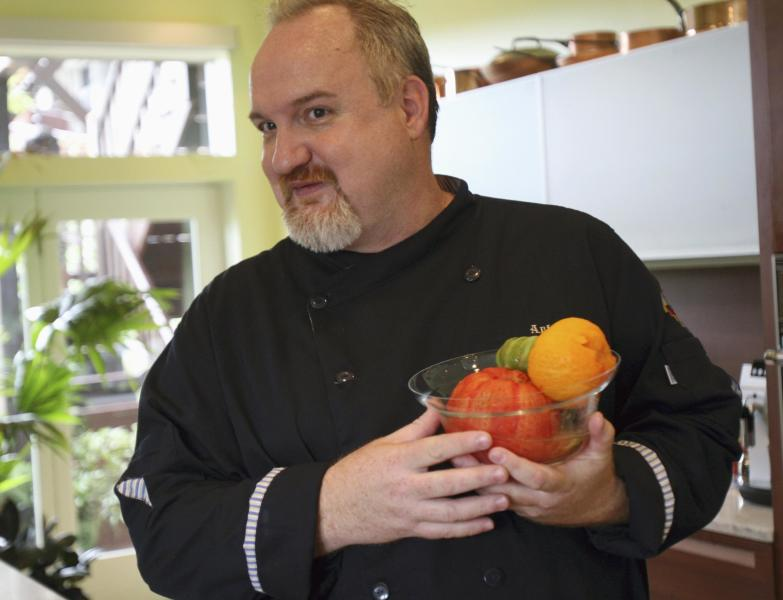 FILE- In this July 19, 2007 file photo, chef Art Smith poses in the kitchen at his home in Chicago, as he prepares vegetables for gazpacho. Smith was diagnosed with Type 2 diabetes about three years ago. Smith ballooned to 325 pounds until he decided to turn it all around and lose 118 pounds. Now 51, the Jasper, Fla., native, restaurant owner, cookbook writer and food TV personality has kept the weight off. (AP Photo/ Stacie Freudenberg, FILE)