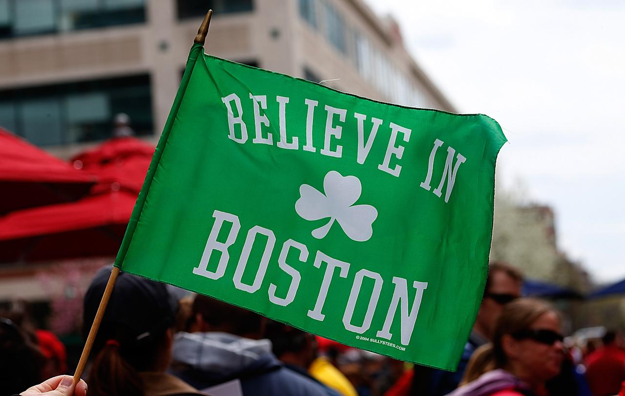 BOSTON, MA - APRIL 20: Fans hold a sign outside of Fenway Park tohonor the Marathon bombing victims, before a game the Kansas City Royals at Fenway Park on April 20, 2013 in Boston, Massachusetts.  (Photo by Jim Rogash/Getty Images)