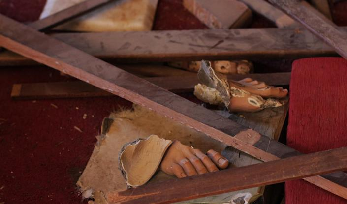 Jesus' feet from a statue that was shot down in the Batnay church by the Islamic State. (Photo: Ash Gallagher for Yahoo News)