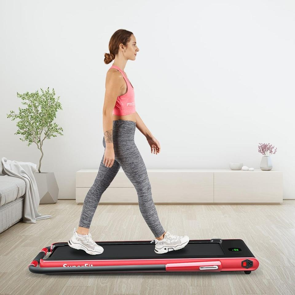 """<p>""""Getting steps in is my favorite way to spend my lunch hour, and my husband and I look forward to walking our dogs as our designated family time. I recently purchased the <span>Goplus 2-in-1 Folding Treadmill</span> ($400, originally $529) for my home, and now I wish I'd bought it years ago. It's a dainty 49""""x27"""" pad with a small bar at the front. Its compact frame also means that it's fairly easy to move. You can fold the handles on this treadmill, making it perfect for placement underneath a standing desk. My daily step count has been dramatically higher since adding this little piece of fitness equipment to my home and, as a result, I feel so much happier and healthier. If you, like me, enjoy walking but can't always physically get outside, I encourage you to hit 'add to cart.'"""" - Emilee Janitz, contributor</p> <p>Read the full <a href=""""https://www.popsugar.com/fitness/goplus-225hp-2-in-1-folding-treadmill-review-48165598"""" class=""""link rapid-noclick-resp"""" rel=""""nofollow noopener"""" target=""""_blank"""" data-ylk=""""slk:Goplus 2-in-1 Folding Treadmill review"""">Goplus 2-in-1 Folding Treadmill review</a>.</p>"""