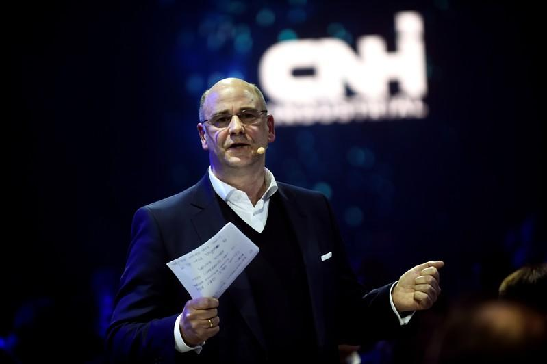 CEO of Italian-American CNH Industrial Hubertus Muhlhauser gestures during the dinner